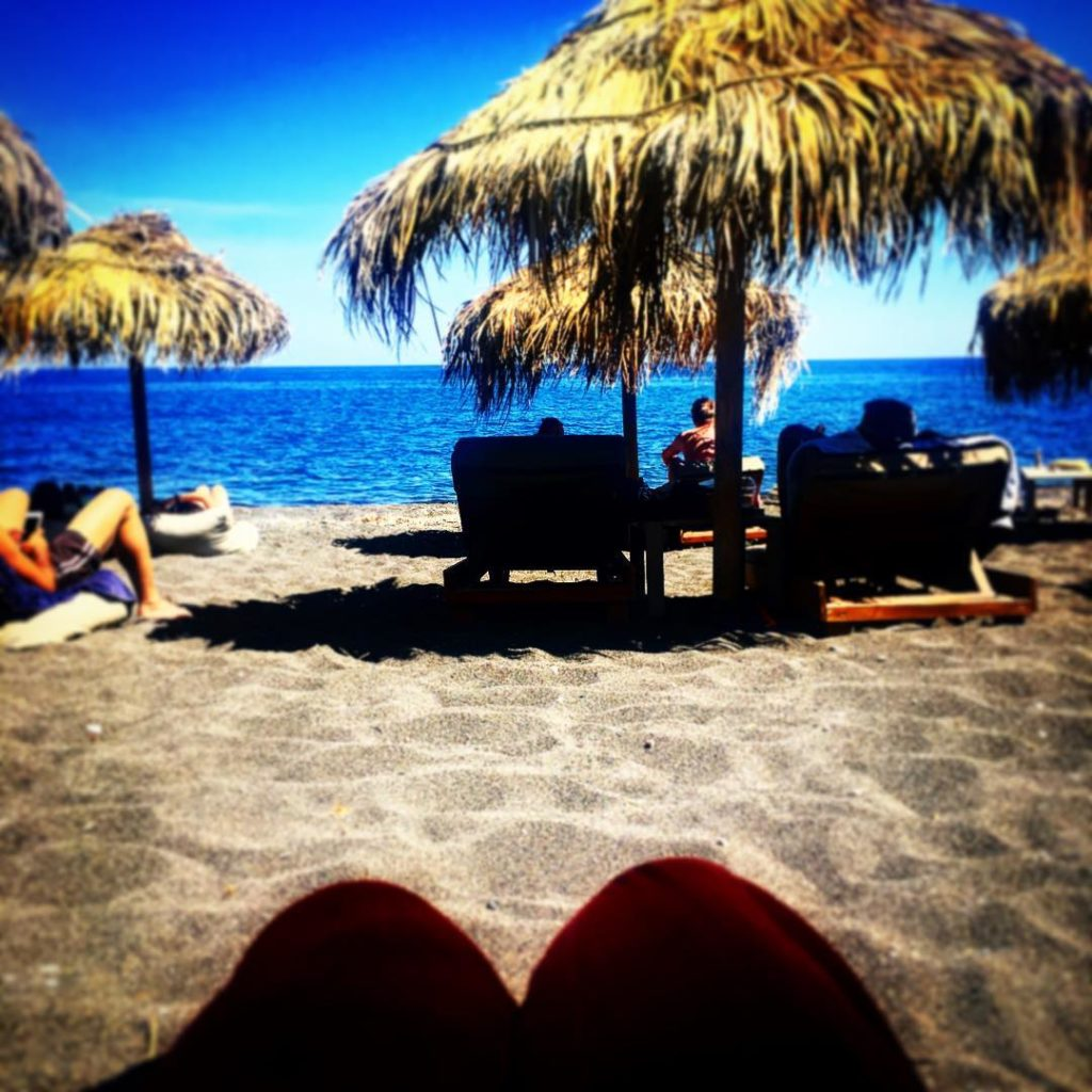Santorini beachbar blackbeach holidays relaxation